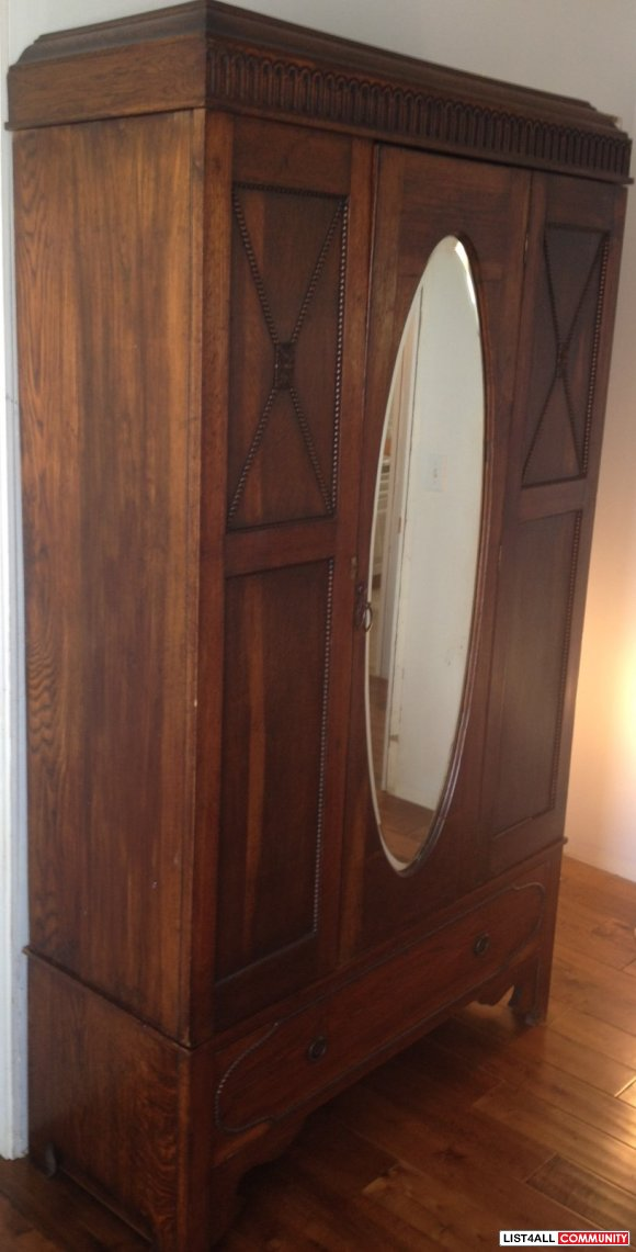 Antique Armoire with Oval Mirror