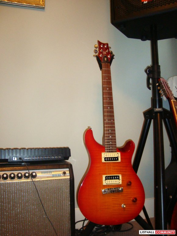 PRS SE custom electric guitar, in perfect immaculate condition